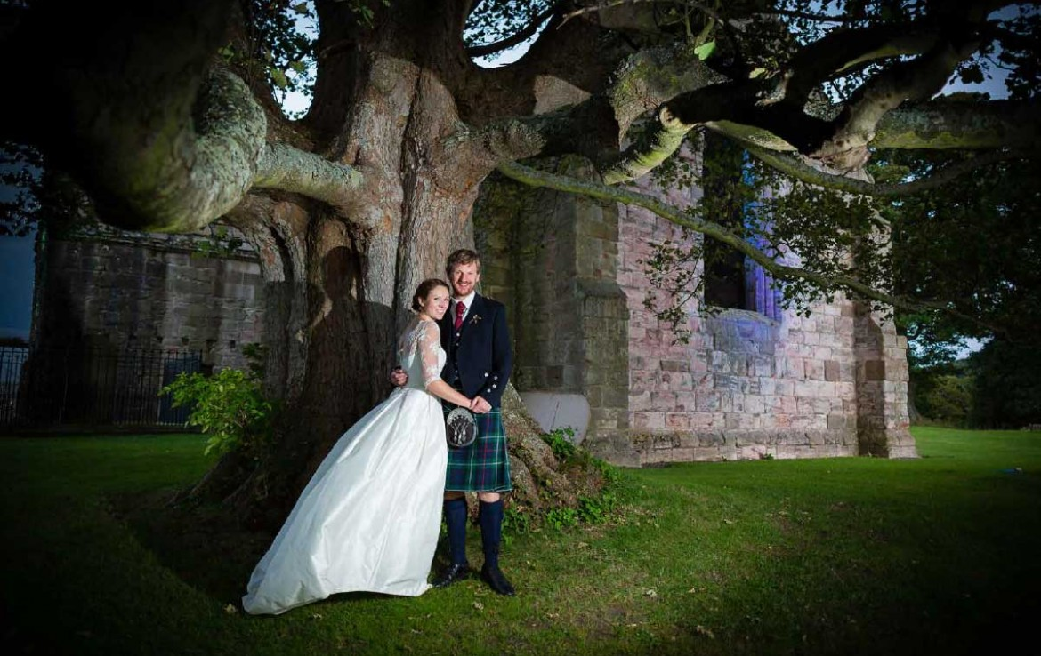 Bride and Groom having their photo taken outside at Dunglass Estate Country House