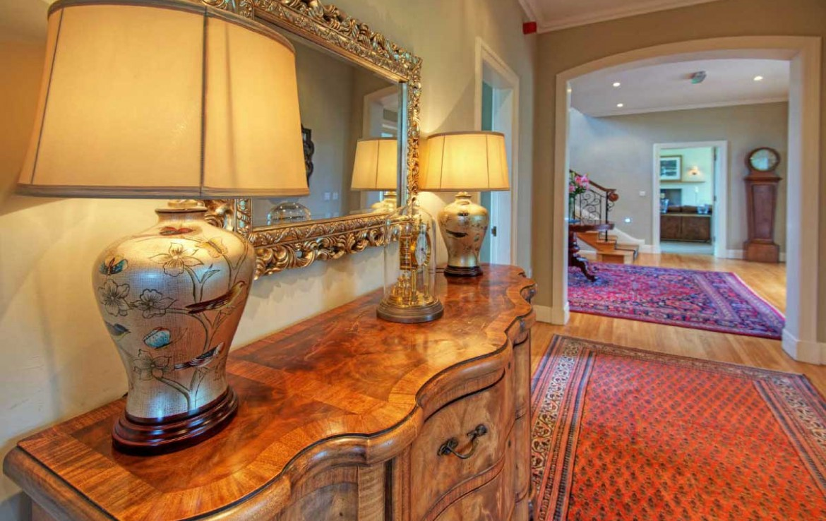 Hallway of Dunglass Estate with persian carpets and antique lamops