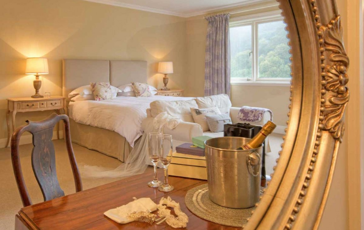 Bridal cottage at Dunglass House with double bed and champage in ice bucket