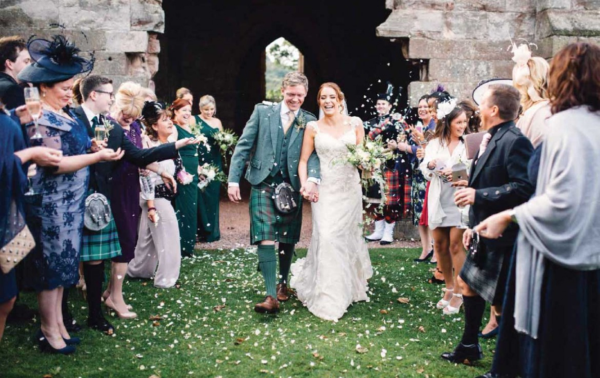 Wedding couple coming out of Dunglass Estate chapel